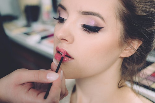 image of woman using lip tint